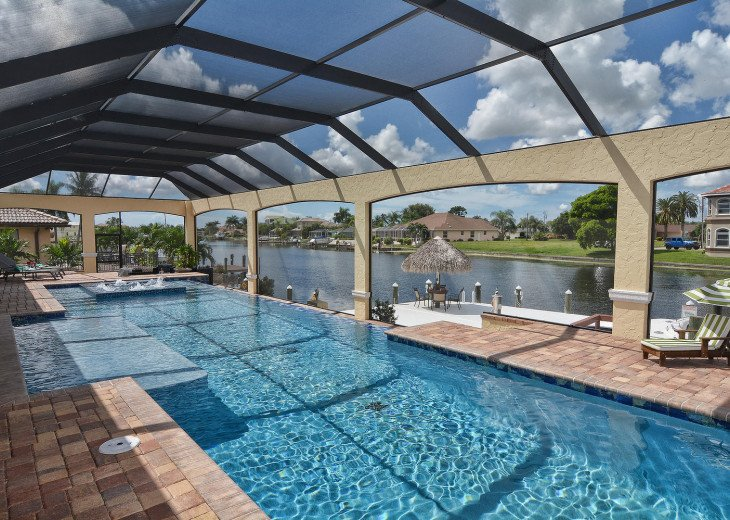 Caribbean Island Dolphin View - 54 ft log pool/ spa, dock 2 min. to the river #74