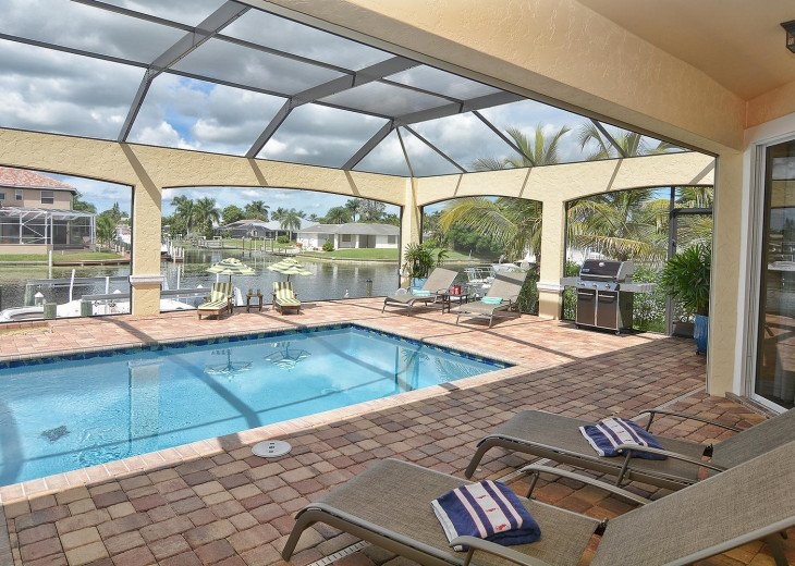 Caribbean Island Dolphin View - 54 ft log pool/ spa, dock 2 min. to the river #63