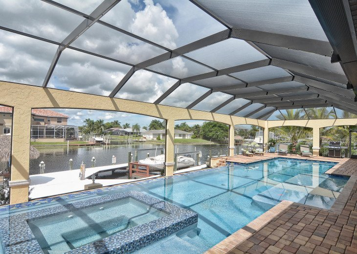 Caribbean Island Dolphin View - 54 ft log pool/ spa, dock 2 min. to the river #71