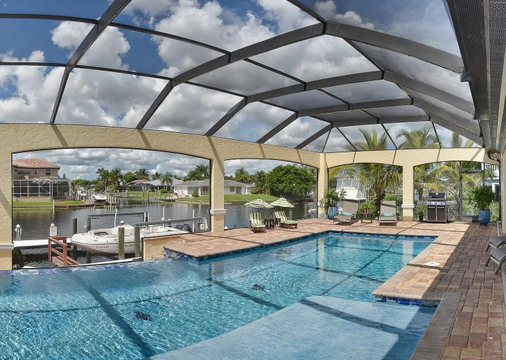 Caribbean Island Dolphin View - 54 ft log pool/ spa, dock 2 min. to the river #76