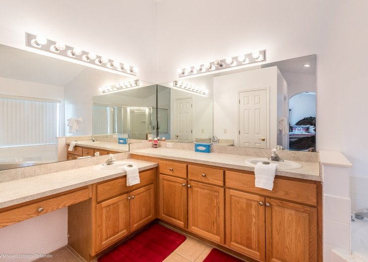 Master Bathroom with his & Vanities and closets