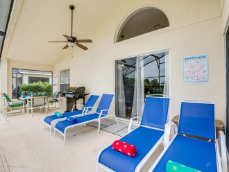 Nice pool deck with lots of lounge and a bran new Gas grill.