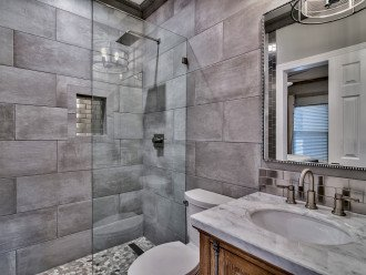 Guest bathroom with walk-in shower. Also accessible from living room