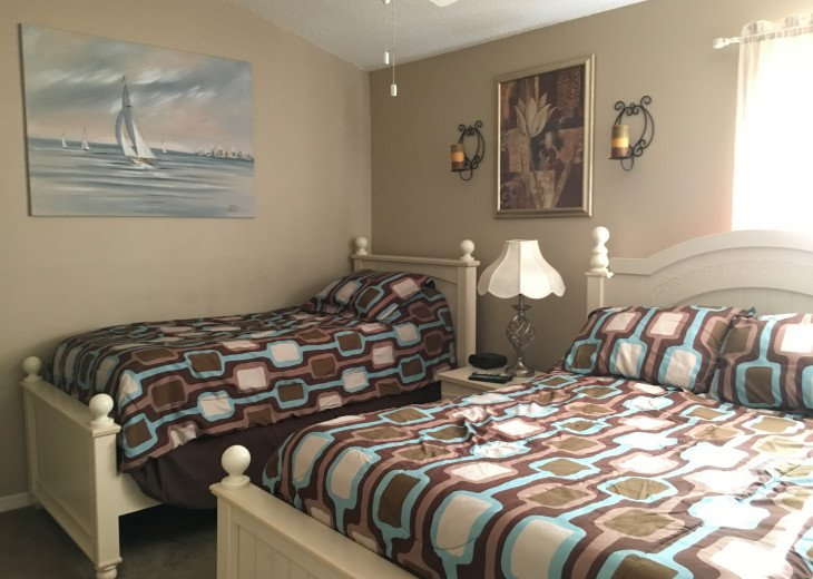 SECOND BEDROOM WITH DOUBLE AND SINGLE BED, T.V AND EN SUITE BATH