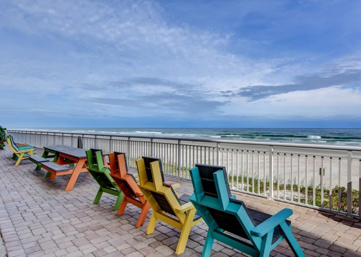 Picnic tables and chairs in Front of Condo