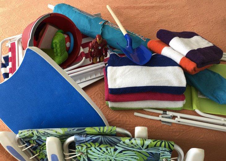 Beach towels. chairs, Umbrella, toys....