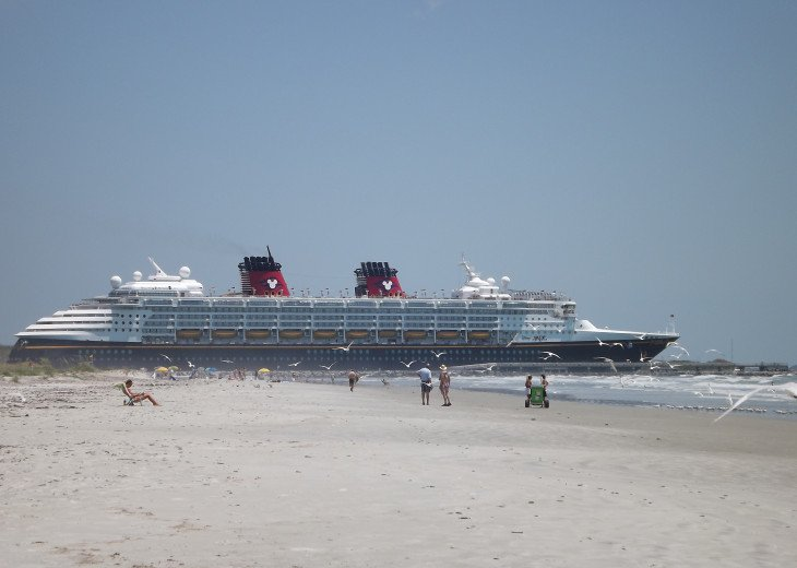 WATCHING A CRUISE SHIP FROM THE BEACH