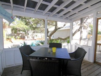 Relax in our screened porch with table and comfortable chairs