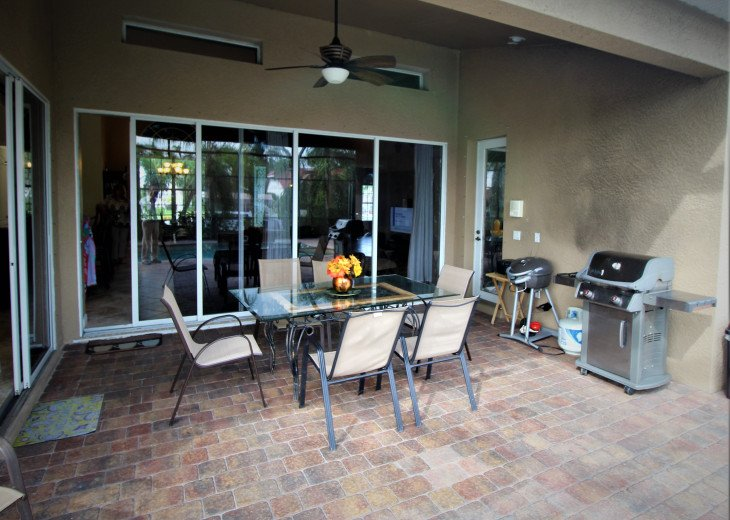 Large Roofed Patio area with Table& Chairs for 8 people, BBQ grill