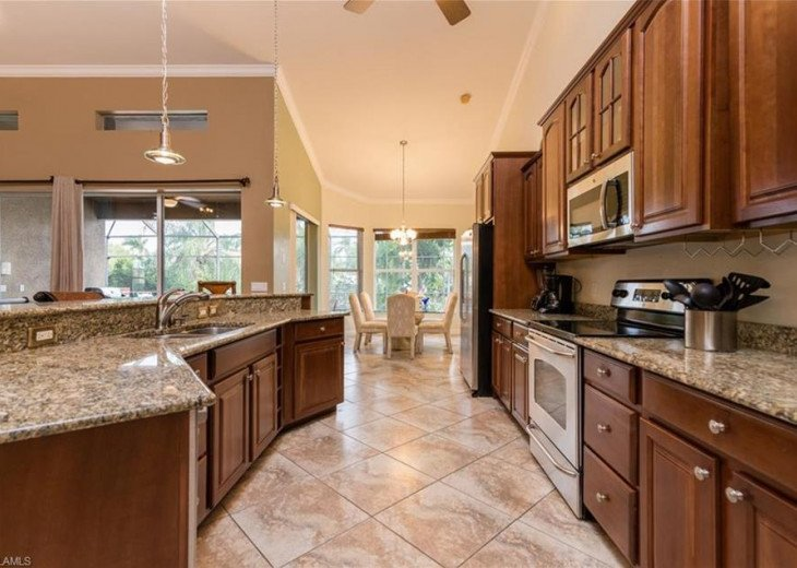 Large open Kitchen, granite counter tops and a breakfast bar, fully equipped