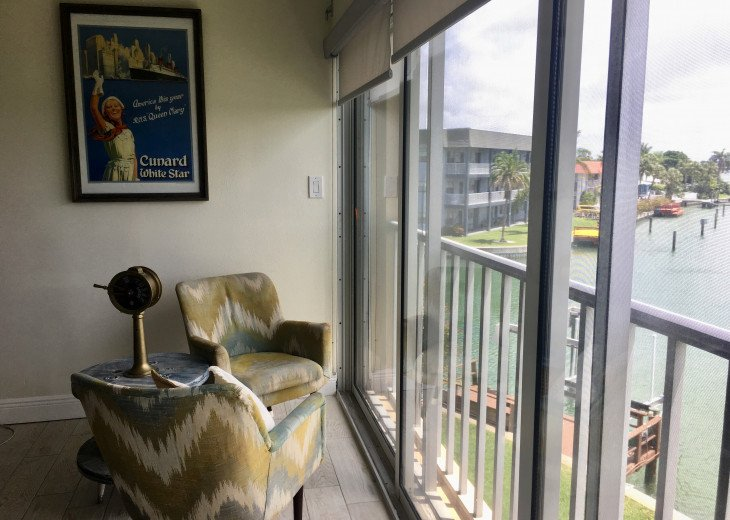 Wall of sliding glass windows stuns with canal view