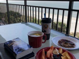Eating on the balcony facing the Gulf