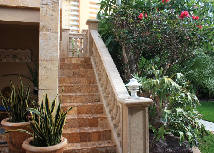Rear Staircase to exclusive garden patio with 2 lounges