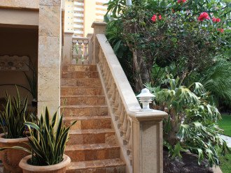 Rear marble staircase to rear garden patio with 2 lounges exclusive to PH