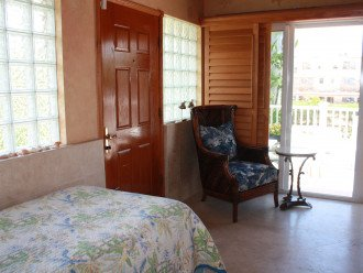 Single Bedroom with sliders to furnished balcony with Ocean Breezes