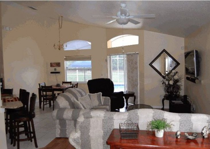 10 Min From Disney,wi-fi,netflix, gas heated private pool,2 masterbed, sleeps 8 #19