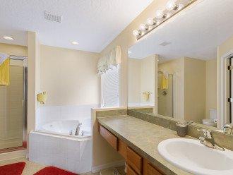 Main master en-suite, bath, shower, hairdryer, walk-in closet