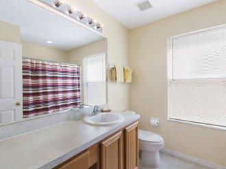 Family bathroom, shower over the bath, hairdt