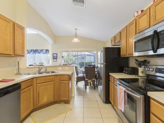 Prepare a family meal in the well equipped kitchen, stove, microwave