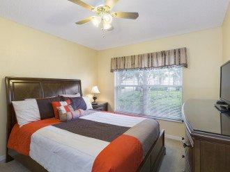 Ground floor bedroom, queen bed, TV/DVD, ceiling fan, closet
