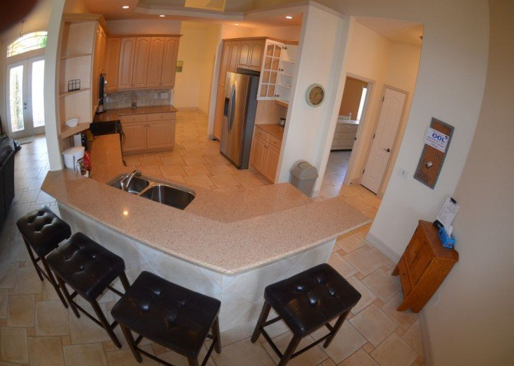 LARGE FULLY EQUIPPED KITCHEN, KITCHEN BAR , stainless Steel appliances.