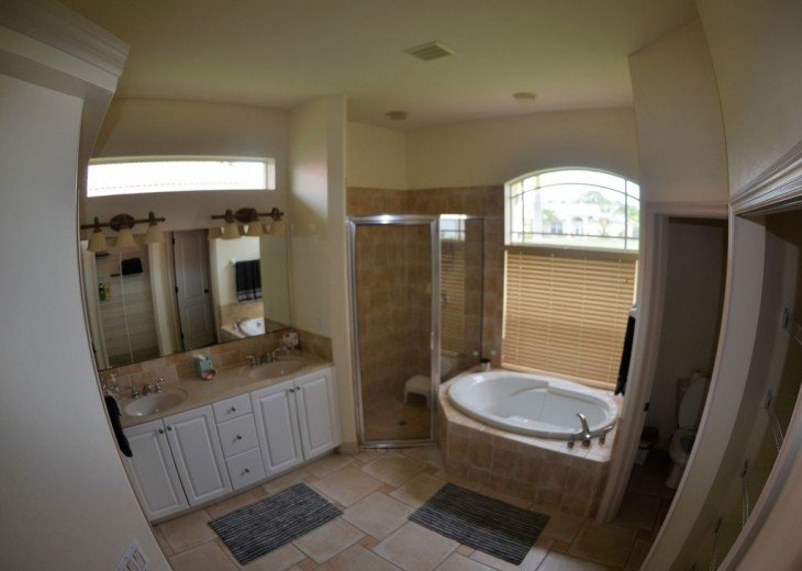 MASTER BATH ROOM With JETTED TUB & walk in SHOWER, vanities.