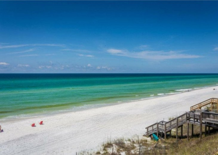 Across the street only steps to the Beach with private access!