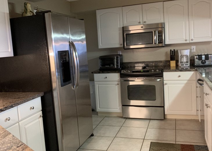 Large Kitchen with stainless steel appliances and granite countertops