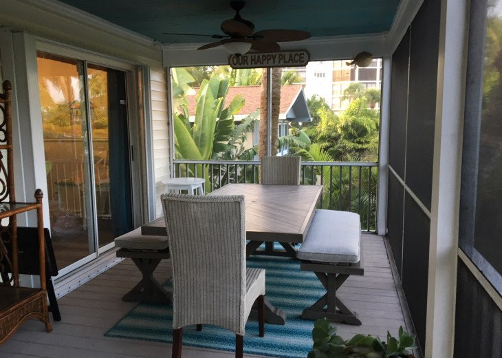 Screened porch dining area with seating for 8