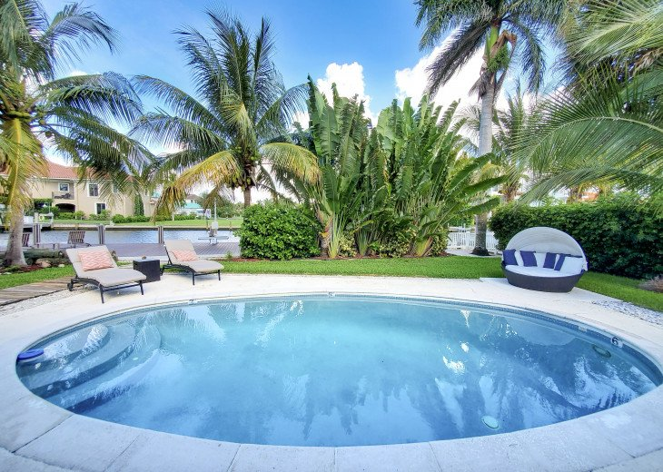 Waterfront escape with boat dock, heated pool and minutes from the beach. #28