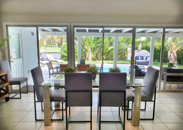 Dining Area overlooking pool and patio