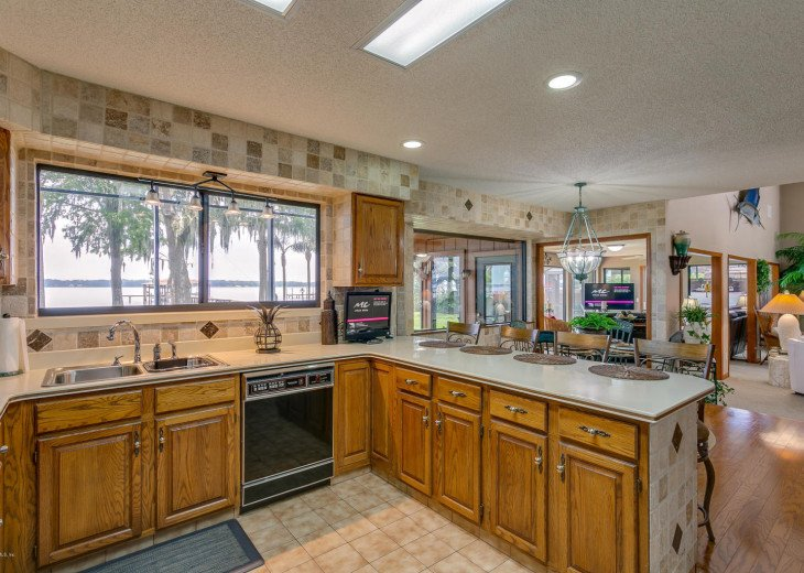 Large kitchen with pass through window to the BBQ area