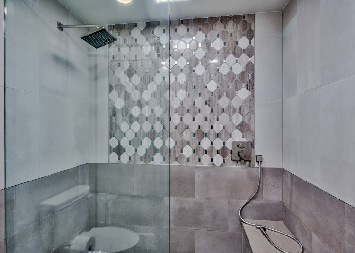 Luxurious fully tiled shower with seamless glass - handicap accessible