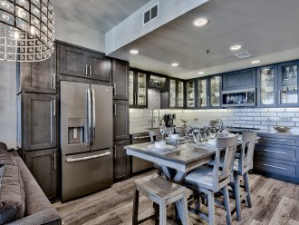 Eat-in Kitchen with granite counters and unique LED lighting