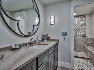 Guest Bathroom with quartz counters and walk-in shower