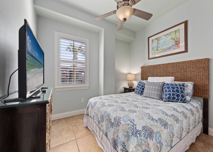 First level queen bedroom with views of the beach and Gulf of Mexico!