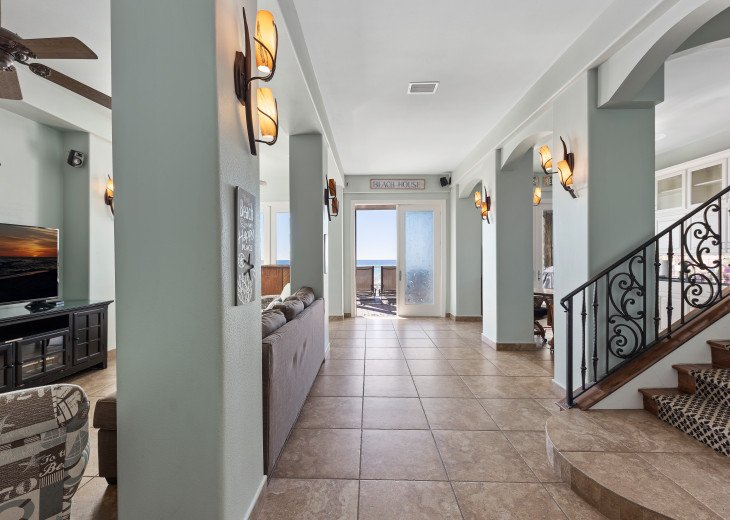 First level hallway to second living area, kitchenette and beach access