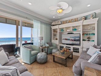 Main living area overlooking the beach from 2 sleeper sofas and swivel chairs!