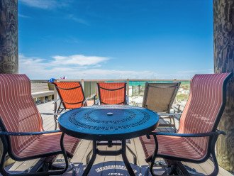 Enjoy drinks or lunch on the first level deck overlooking the beach!