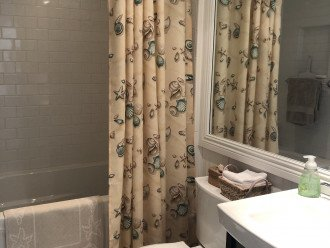 Guest bathroom with tub, comfort height toilet.