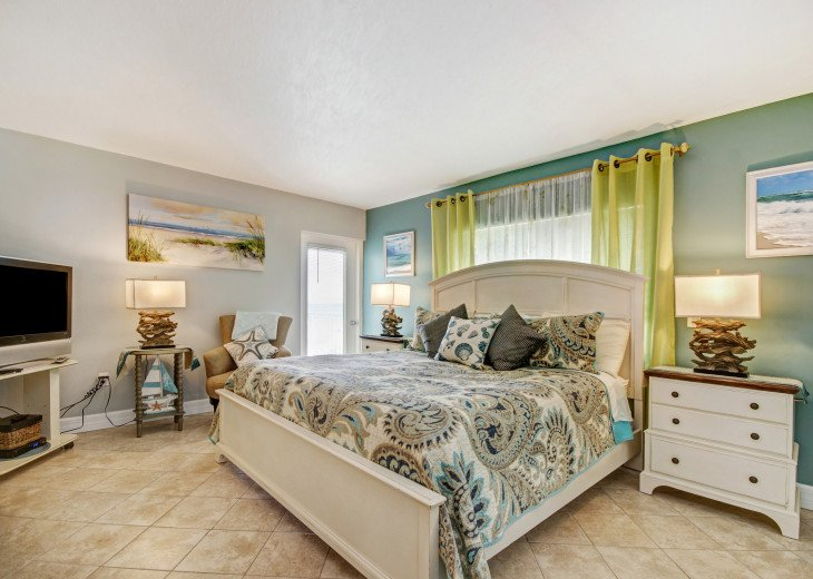 A very large master bedroom with a king bed
