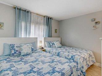 Two queens beds in the second bedroom