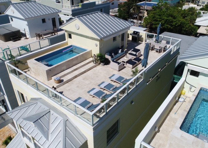 Rooftop is complete with grilling/dining area, lounging, sunning and swimming