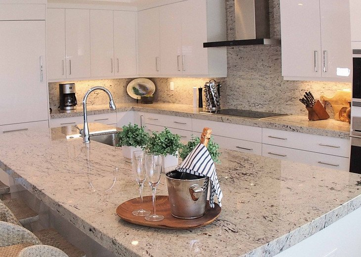 Enjoy gathering in the gleaming chef's kitchen, with high end appliances
