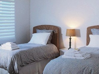 East bedroom can be set up with one king-size bed or two twin beds