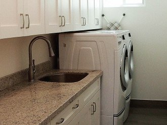 Laundry room, ironing board and clothes steamer are all here for you