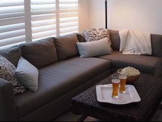 This couch pulls out into a family-sized chaise for watching the game or a movie