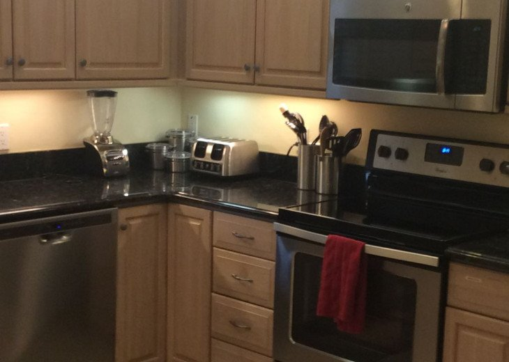 Kitchen with stainless-steel appliances - Naples Vacation Rental