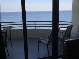 LIVING ROOM VIEW OF BALCONY AND OCEAN