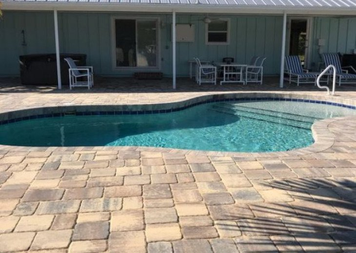 Beautiful pool and large backyard with grill for entertaining